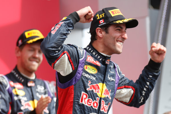 Circuit Gilles Villeneuve, Montreal, Canada. Sunday 8 June 2014. Daniel Ricciardo, Red Bull Racing, 1st Position, celebrates his maiden win on the podium. World Copyright: Alastair Staley/LAT Photographic. ref: Digital Image _79P0957