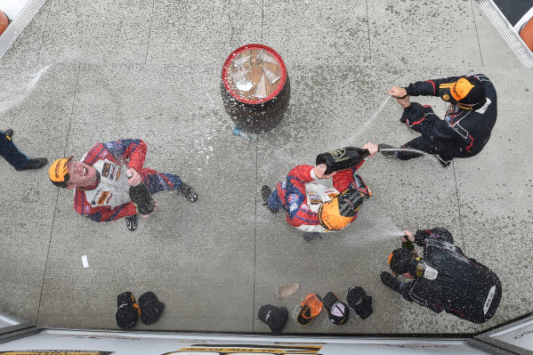 26-28 June, 2014, Watkins Glen, New York USA 6, Camaro, GS.R, GS, Robin Liddell, Andrew Davis 14, Nissan, 370Z, GS, BJ Zacharias, Brad Jaeger, 13, Porsche, 997, GS, Matt Plumb, Nick Longhi celebrate the win on the podium with champagne  ?2014 Scott R LePage LAT Photo USA