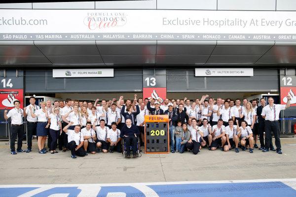Silverstone, Northamptonshire, England. Saturday 5 July 2014. Felipe Massa, Williams F1, celebrates his 200th Grand Prix with his current team, Williams F1. World Copyright: Glenn Dunbar/LAT Photographic. ref: Digital Image _89P1927