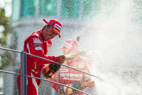 Autodromo Nazionale di Monza, Monza, Italy.12th September 2010.Fernando Alonso, Ferrari F10, 1st position, and Felipe Massa, Ferrari F10, 3rd position, spray champagne on the podium. Portrait. Podium.World Copyright: Andrew Ferraro/LAT Photographicref: Digital Image _Q0C1578