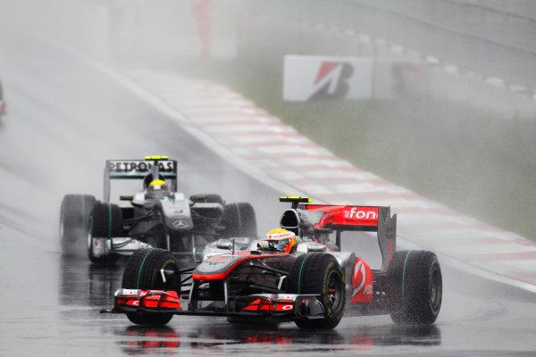 Korea International Circuit, Yeongam-Gun,South Korea.24th October 2010.Lewis Hamilton, McLaren MP4-25 Mercedes, 2nd position, leads Nico Rosberg, Mercedes GP W01, retired. Action. World Copyright:Andrew Ferraro/LAT Photographicref: Digital Image _G7C2100