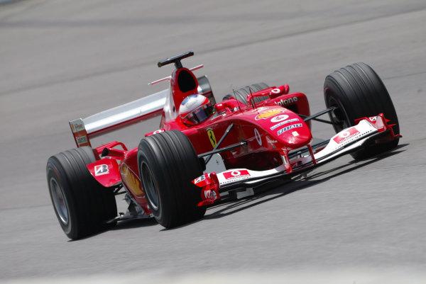 2004 United States Grand Prix - Friday Practice,Indianapolis, USA. 18th June 2004 Rubens Barrichello, Ferrari F2004, action.World Copyright: Steve Etherington/LAT Photographic ref: Digital Image Only