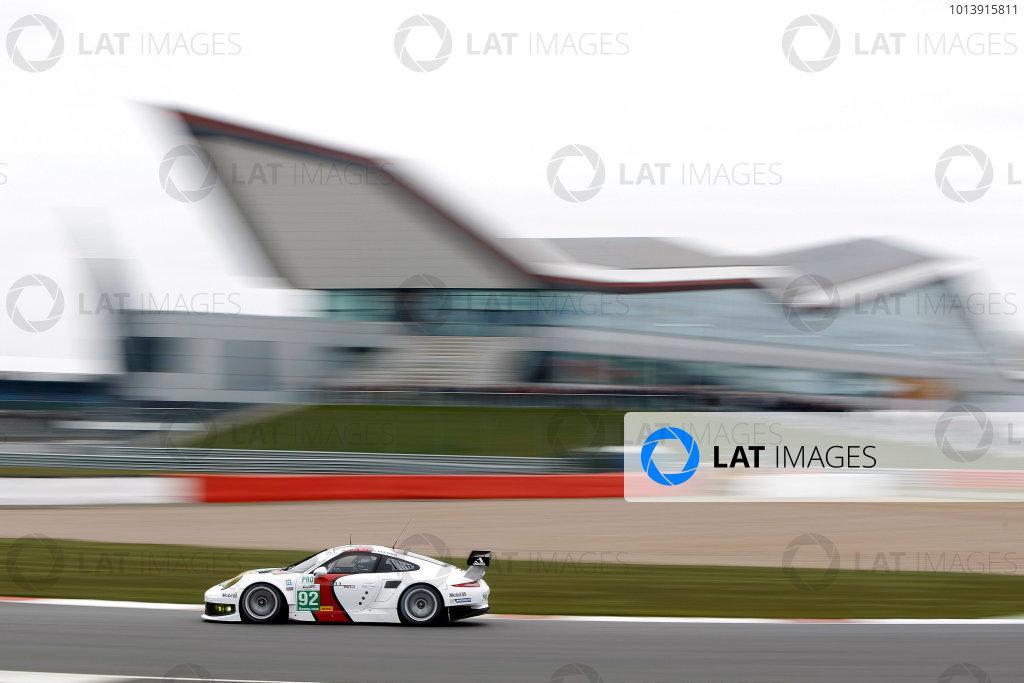 2013 FIA WEC Championship, Silverstone, Northamptonshire. 12th - 14th April 2013. Marc Lieb / Richard Lietz / Romain Dumas Porsche AG Team Manthey Porsche 911 RSR World Copyright: Ebrey / LAT Photographic.