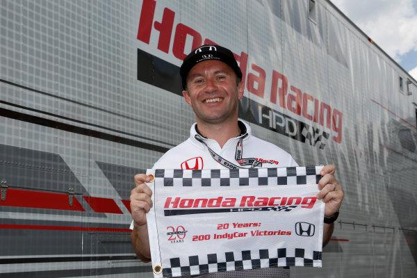 4-7 July, 2013, Long Pond, PA, USA Honda HPD technical director Roger Griffiths celebrates 200 Honda IndyCar wins © 2013, Michael L. Levitt LAT Photo USA.