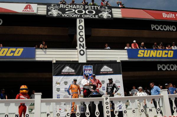 4-7 July, 2013, Pocono, Pennsylvania USA Charlie Kimball, Chip Ganassi, Scott Dixon and Dario Franchitti stand on the winner's podium ©2013, Gregg Feistman LAT Photo USA .