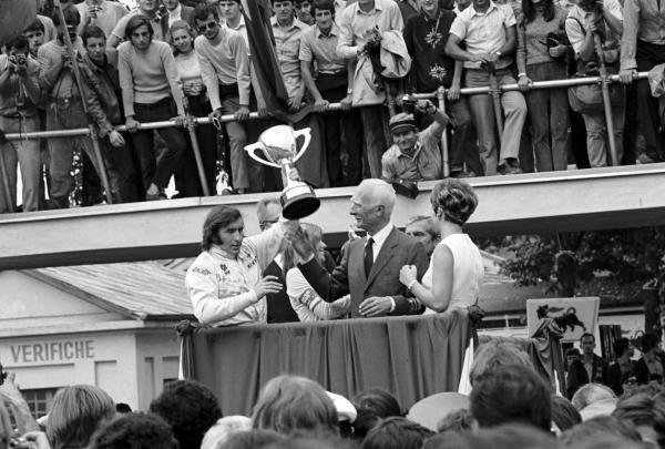 Jackie Stewart(GBR) Matra MS80 holds the winners trophy aloft Italian GP, Monza, 8 September 1969