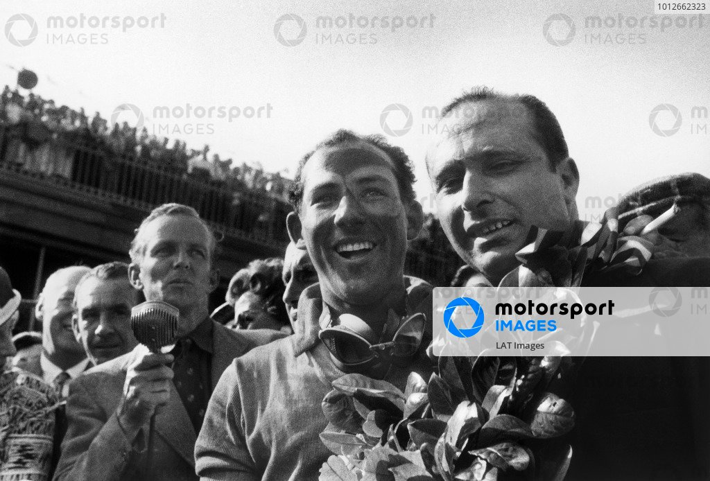 Aintree, Great Britain. 16th July 1955.Stirling Moss (Mercedes-Benz W196) 1st position, and Juan Manuel Fangio (Mercedes-Benz W196) 2nd position, portrait, podium.World Copyright: LAT Photographic.Ref: Autosport b&w print.