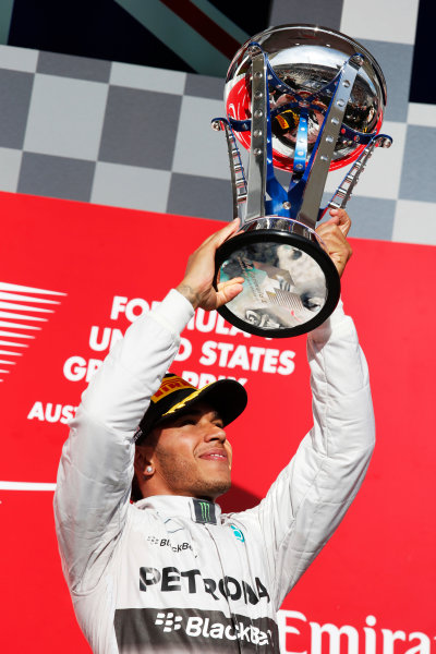 Circuit of the Americas, Austin, Texas, United States of America. Sunday 2 November 2014. Lewis Hamilton, Mercedes AMG, 1st Position, lifts his trophy. World Copyright: Steven Tee/LAT Photographic. ref: Digital Image _L4R9832
