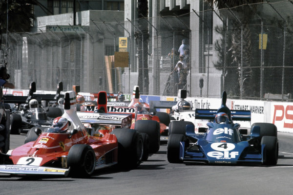 Long Beach, California, USA. 26 - 28 March 1976. Clay Regazzoni (Ferrari 312T), 1st position, leads Patrick Depailler (Tyrrell 007-Ford), 3rd position and James Hunt (McLaren M23-Ford), retired, at the start, action.  World Copyright: LAT Photographic. Ref:  76LB12.