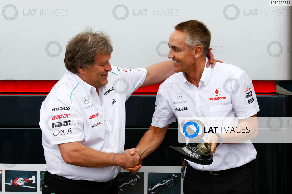 Valencia Street Circuit, Valencia, Spain22nd June 2012.Martin Whitmarsh, Team Principal, McLaren, receives a trophy from Norbert Haug, Vice President, Mercedes-Benz High Performance Engines, made using the wheel nut from the winning car of Lewis Hamilton last weekend and the wheel nut from the race winning MP4-12 of David Coulthard from the 1997 Australian Grand Prix.World Copyright:Charles Coates/LAT Photographicref: Digital Image _26Y9045