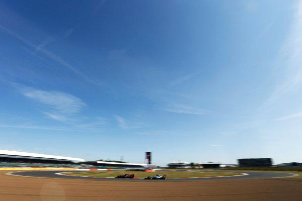 Silverstone Circuit, Northamptonshire, England. Friday 3 July 2015. Max Verstappen, Toro Rosso STR10 Renault, leads Lewis Hamilton, Mercedes F1 W06 Hybrid. World Copyright: Andrew Ferraro/LAT Photographic ref: Digital Image _FER0206