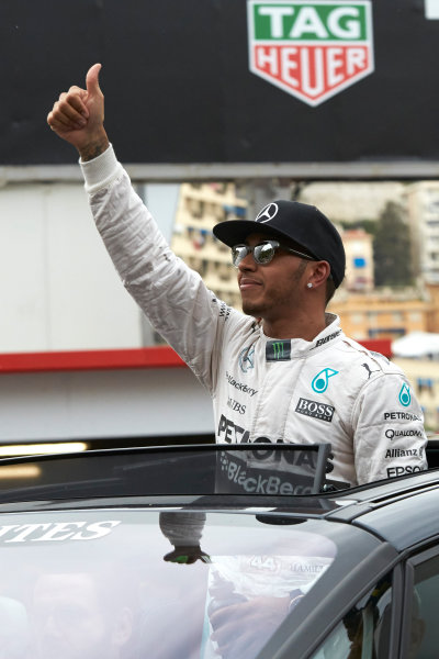 Monte Carlo, Monaco. Saturday 23 May 2015. Pole starter Lewis Hamilton, Mercedes AMG, is driven away from Parc Ferme after qualifying. World Copyright: Steve Etherington/LAT Photographic. ref: Digital Image SNE26604