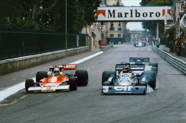 Monte Carlo, Monaco. 20-22 May 1977. Jochen Mass (McLaren M23 Ford) overtakes Ronnie Peterson (Tyrrell P34 Ford) with Mario Andretti (Lotus 78 Ford) in pursuit. Mass and Andretti finished in 4th and 5th positions respectively. World Copyright - LAT Photographic Ref: 77MON27.