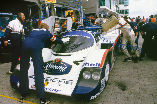Nurburgring, Germany. 15th July 1984. Rd 4.Stefan Bellof/Derek Bell (Porsche 956), 1st position, pit stop action. World Copyright: LAT Photographic.Ref:  84SCARS