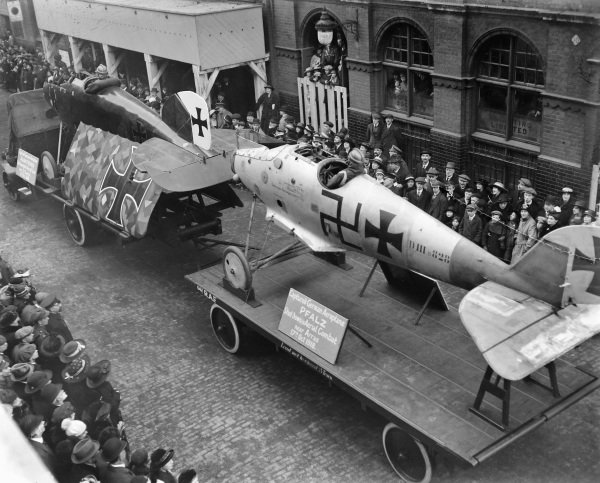 Downed German biplanes are displayed during the Lord Mayor's Show, in Tudor Street, London. On the left is an Albatros shot down by anti-aircraft guns near St. Quentin on 3rd October 1918, on the right is a Pfalz shot down in a dogfight near Arras on 17th October 1918.