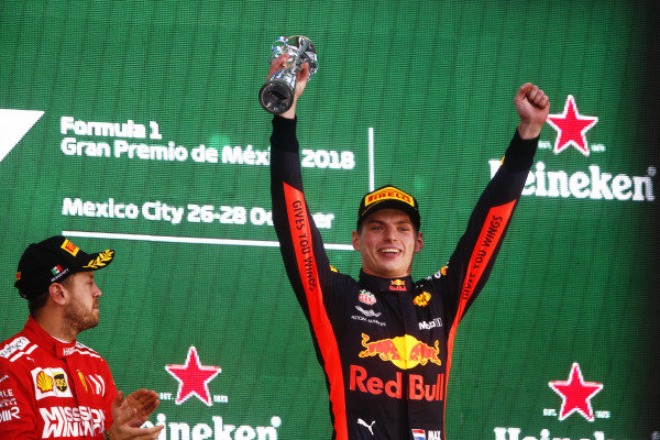 Winner Max Verstappen, Red Bull Racing, celebrates on the podium with Sebastian Vettel, Ferrari