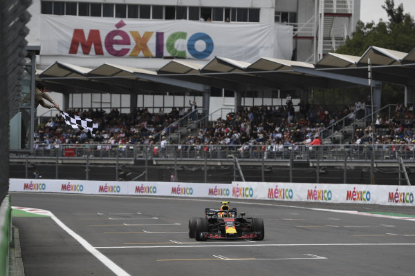 Race Winner Max Verstappen, Red Bull Racing RB14 crosses the finish line