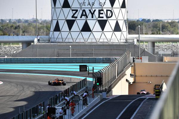 Carlos Sainz Jr, McLaren MCL33 and Lance Stroll, Racing Point Force India VJM11