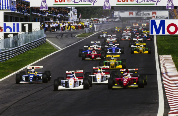Mika Häkkinen, McLaren MP4-8 Ford, leads Jean Alesi, Ferrari F93A, Ayrton Senna, McLaren MP4-8 Ford, and Alain Prost, Williams FW15C Renault, at the start.