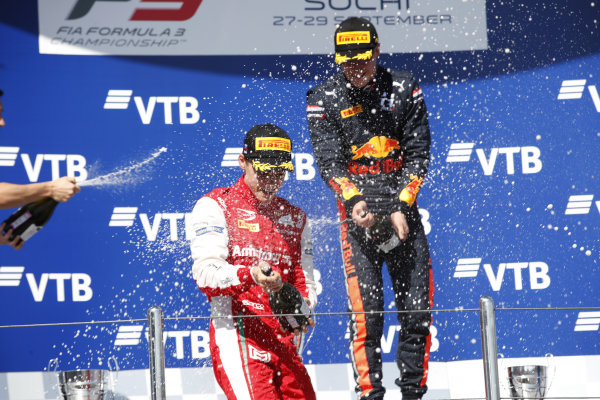 SOCHI AUTODROM, RUSSIAN FEDERATION - SEPTEMBER 29: Race winner Juri Vips (EST) Hitech Grand Prix, Marcus Armstrong (NZL) PREMA Racing spray champagne on the podium during the Sochi at Sochi Autodrom on September 29, 2019 in Sochi Autodrom, Russian Federation. (Photo by Joe Portlock / LAT Images / FIA F3 Championship)