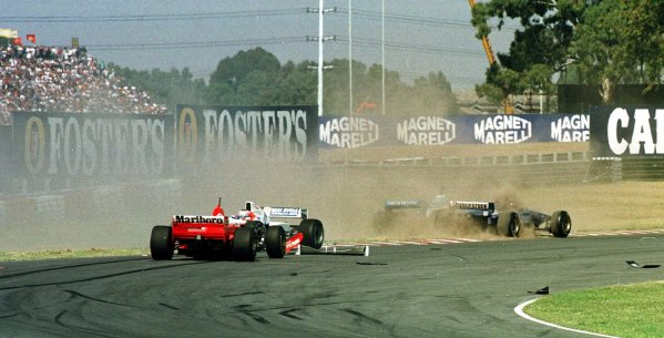 1997 Argentinian Grand Prix.Buenos Aires, Argentina.11-13 April 1997.Michael Schumacher (Ferrari F310B) crashes out on the first lap of the race.World Copyright - LAT Photographic