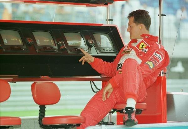 1998 Austrian Grand Prix.A1-Ring, Zeltweg, Austria.24-26 July 1998.Michael Schumacher (Ferrari) looks at the timing screens.World Copyright - Steve Etherington/LAT Photographic