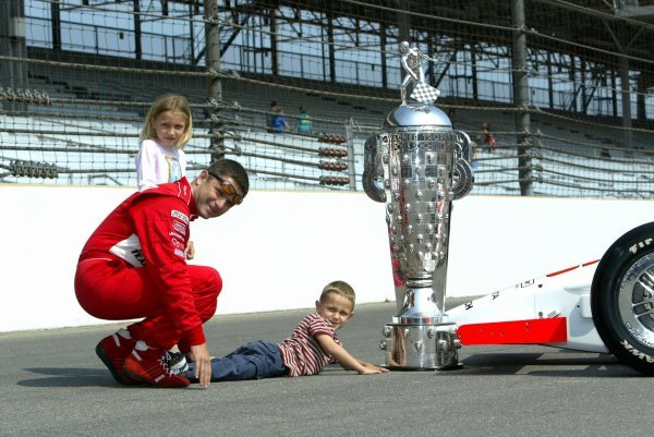 Gil de Ferran (BRA) Penske Racing G-Force Toyota, with daughter Anna and son Luke,  celebrates his first Indy 500 victory with the famous trophy.Indy Racing League, Indianapolis 500, Indianapolis, USA, 26 May 2003.DIGITAL IMAGE