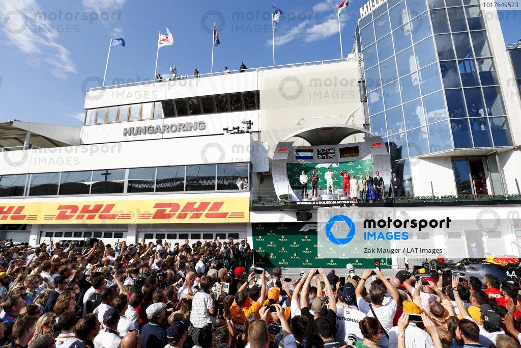 James Vowles, Motorsport Strategy Director, Mercedes AMG F1, Max Verstappen, Red Bull Racing, Race winner Lewis Hamilton, Mercedes AMG F1 and Sebastian Vettel, Ferrari celebrate on the podium over the top of Parc Ferme