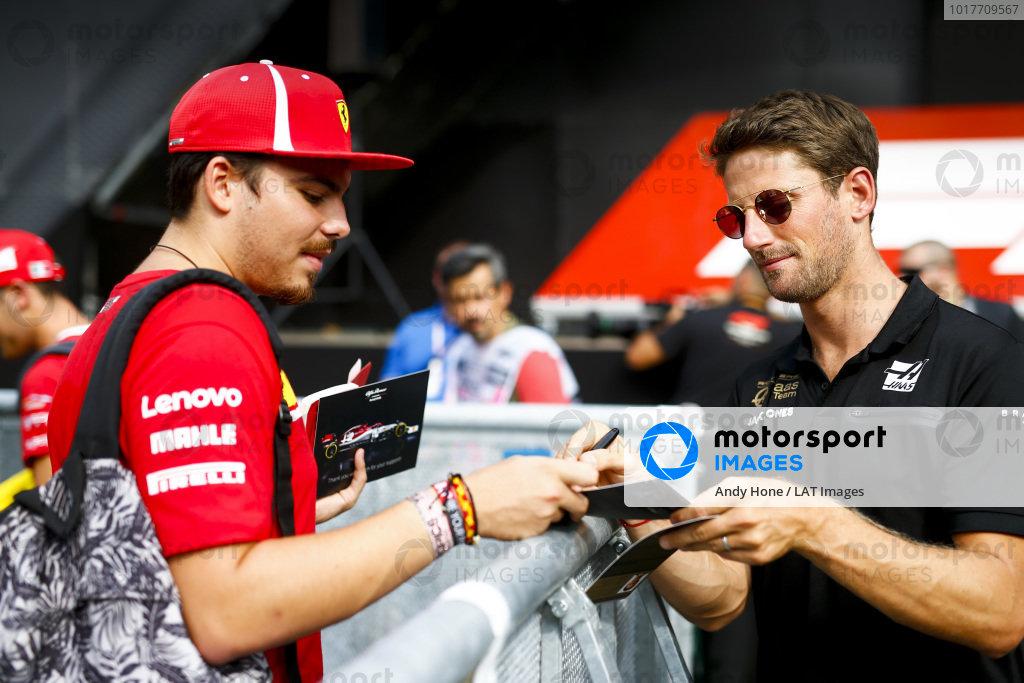 Romain Grosjean, Haas F1 signs an autograph for a fan