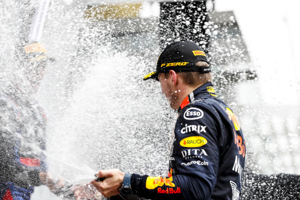 Max Verstappen, Red Bull Racing, 1st position, sprays Champagne on the podium