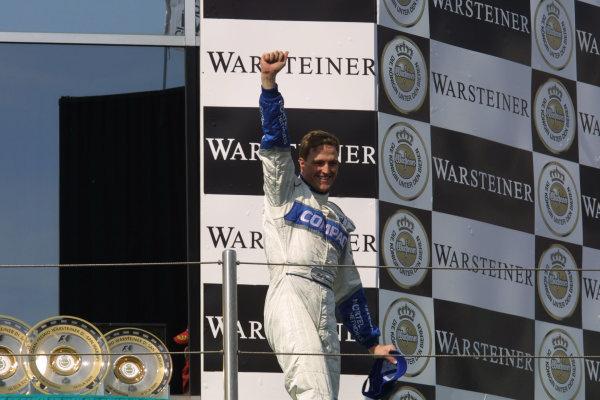 2001 San Marino Grand Prix.Imola, Italy. 13-15 April 2001.Ralf Schumacher (Williams BMW) celebrates his maiden Grand Prix win on the podium.World Copyright - LAT Photographicref: 8 9 MB Digital