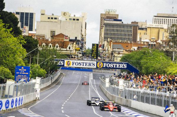 Stefan Johansson, Ferrari F1/86, leads Riccardo Patrese, Brabham BT55 BMW, and Patrick Tambay, Lola THL-2 Ford.