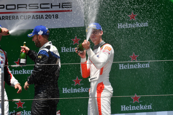 Race winner Philip Hamprecht (GER) Team StarChase and third placed Chris Van Der Drift (NZL) Team Formax celebrate on the podium with the champagne at Porsche Carrera Cup Asia, Shanghai, China, 13-15 April 2018.