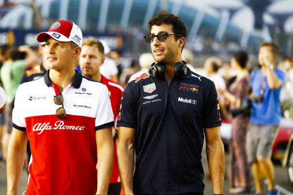 Marcus Ericsson, Alfa Romeo Sauber, and Daniel Ricciardo, Red Bull Racing, at the drivers parade
