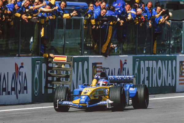 Fernando Alonso, Renault R23, celebrates his maiden podium finish with the team.