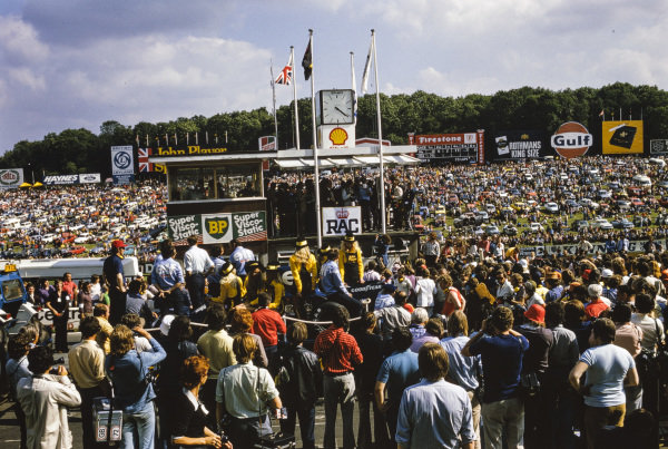 Jody Scheckter celebrates victory on the podium.