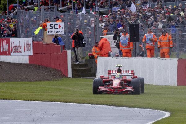 Felipe Massa, Ferrari F2008 spins off the track in the wet conditions.