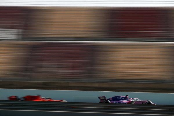 Lance Stroll, SportPesa Racing Point F1 Team RP19 and Charles Leclerc, Ferrari SF90