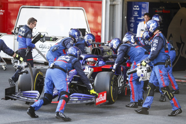 Daniil Kvyat, Toro Rosso STR14 being pushed into the garage after retiring from the race