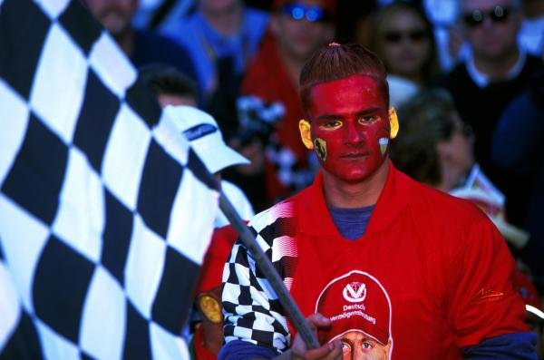 Do my ears notice too much? A Ferrari fan at Indy. American Grand Prix, Indianapolis, USA, 30 September 2001.