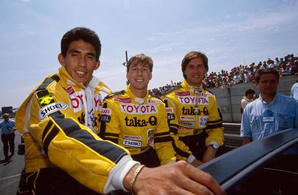 Aguri Suzuki (JPN), Johnny Dumfries (GBR), Roberto Ravaglia (ITA) TOM'S Toyota teammates during the driver's parade.