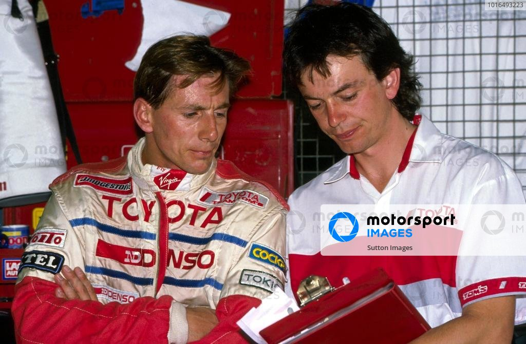 Johnny Dumfries (GBR) TOM'S Toyota talks with his engineer.World Sportscar Championship, 1990.BEST IMAGE