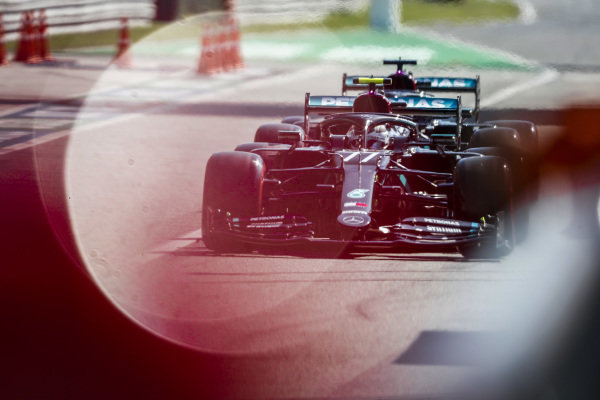 Valtteri Bottas, Mercedes F1 W11 EQ Performance leads Lewis Hamilton, Mercedes F1 W11 EQ Performance out of the pit lane