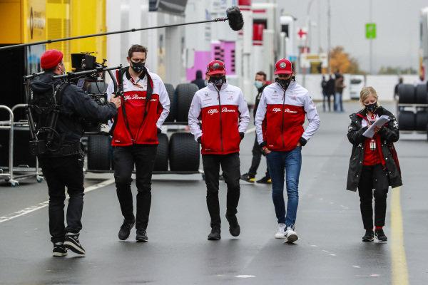 Kimi Raikkonen, Alfa Romeo and Antonio Giovinazzi, Alfa Romeo in the paddock
