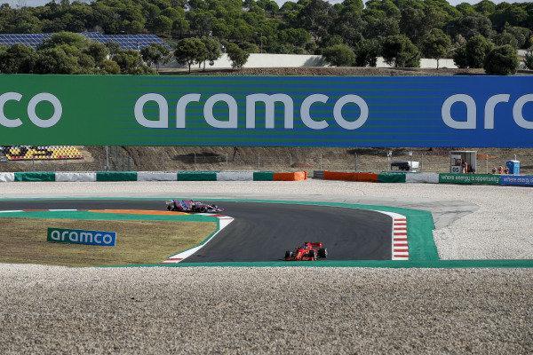 Sebastian Vettel, Ferrari SF1000 and Lance Stroll, Racing Point RP20