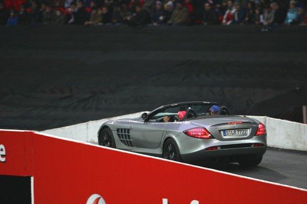 Gavin Jones (GBR) is taken for a ride with Lewis Hamilton (GBR) Mclaren Mercedes SLR. Race Of Champions, Wembley Stadium, London, England, 14 December 2008.