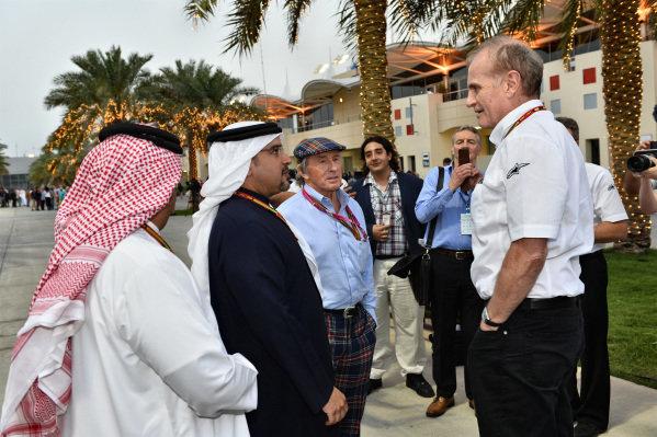 Neil England (GBR) non-Executive Chairman of Silverstone Holdings Ltd talks with Crown Prince Shaikh Salman bin Hamad Al Khalifa (BRN) and Jackie Stewart (GBR). Formula One World Championship, Rd3, Bahrain Grand Prix, Practice, Bahrain International Circuit, Sakhir, Bahrain, Friday 4 April 2014.