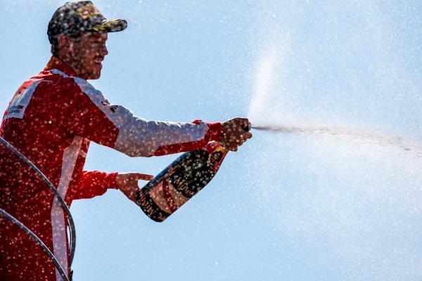 Autodromo Nazionale di Monza, Monza, Italy. Sunday 6 September 2015. Sebastian Vettel, Ferrari, 2nd Position, sprays Champagne from the podium. World Copyright: Steven Tee/LAT Photographic ref: Digital Image _L4R6694