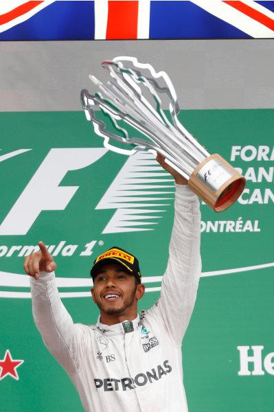 Circuit Gilles Villeneuve, Montreal, Canada. Sunday 12 June 2016. Lewis Hamilton, Mercedes AMG, 1st Position, with his trophy. World Copyright: Glenn Dunbar/LAT Photographic ref: Digital Image _V2I5832