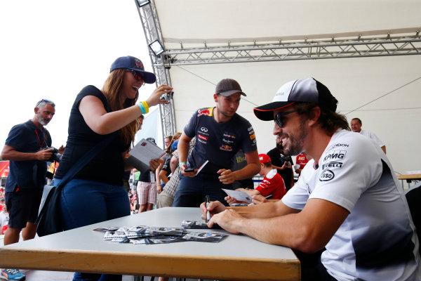 Hockenheim, Germany. Saturday 30 July 2016. Fernando Alonso, McLaren, signs autographs for fans. World Copyright: Andy Hone/LAT Photographic ref: Digital Image _ONZ7583